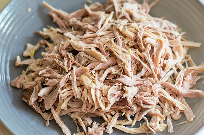 Pile of Chooked Shredded Chicken on a Gray Plate