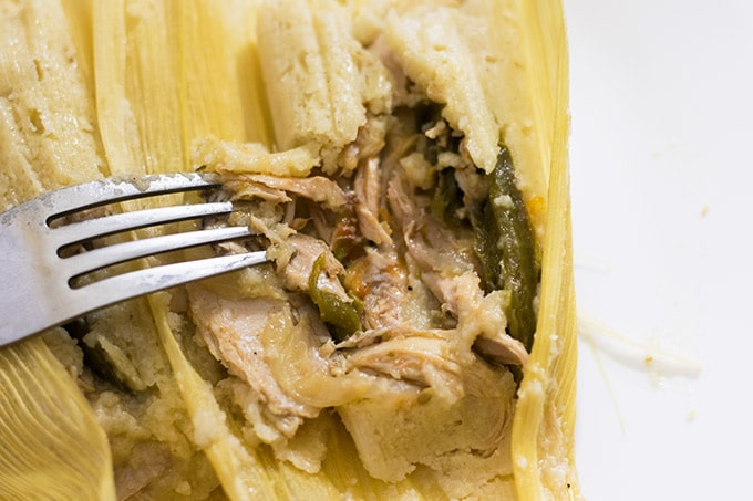 tamales filled chicken and delicious strips of onion, jalapenos and tomatoes