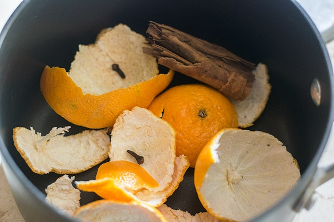 orange peels, cinnamon and cloves in a pot