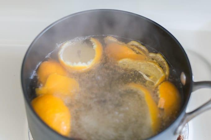 orange peels, cinnamon and cloves boiling