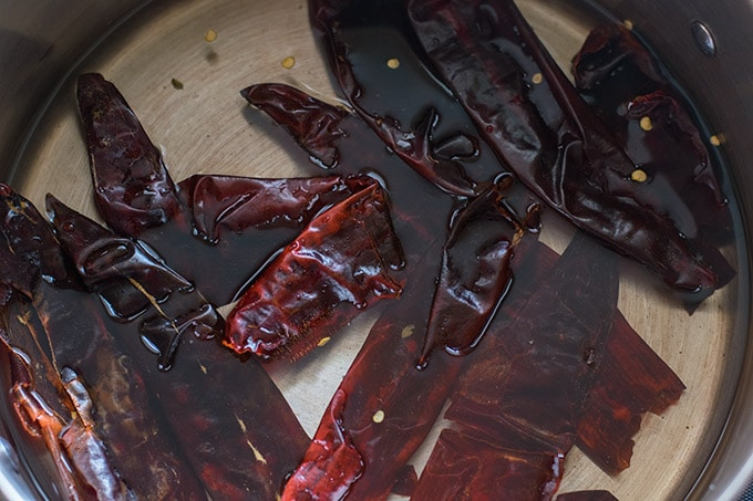guajillo chilies covered in water