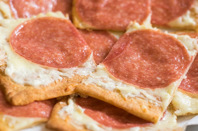 pieces of pizza with salami