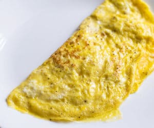 cooked omelet on a white plate