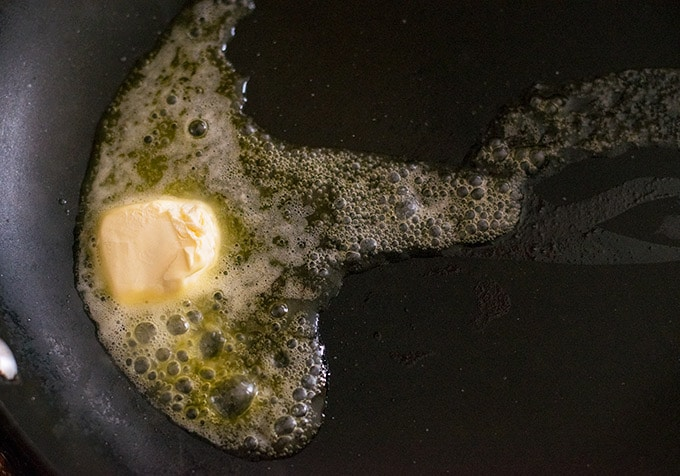 one tablespoon of butter in a pan melting