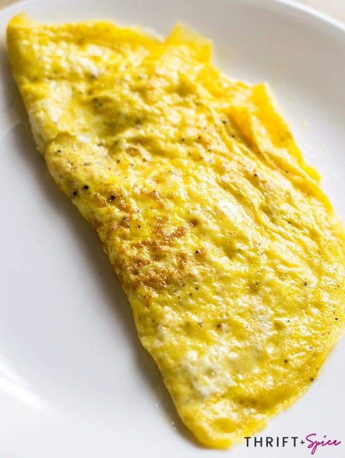 a cheese omelet on a white plate