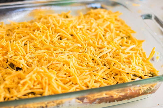 shredded cheese on cornbread