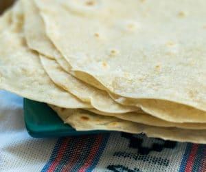 homemade flour tortillas recipe on a blue plate