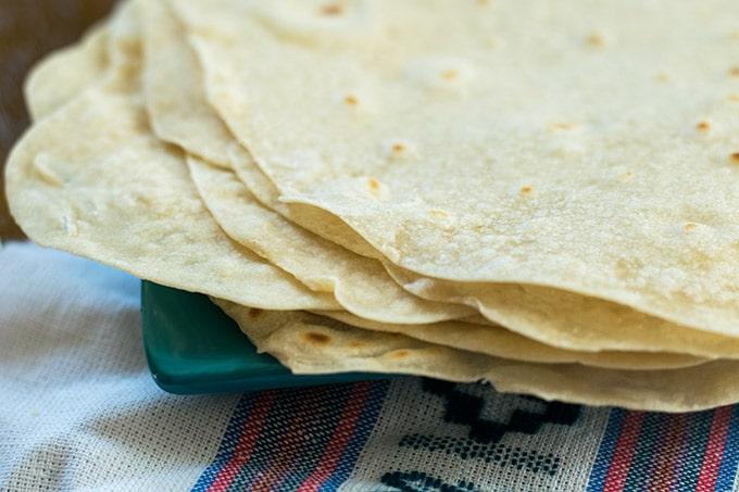 homemade flour tortilla recipe on a blue plate