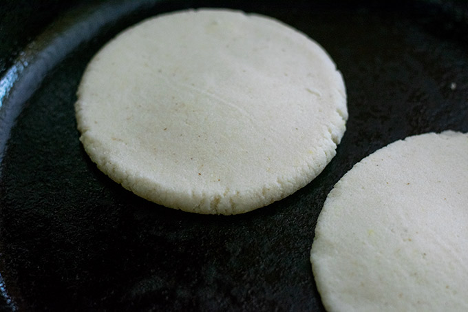 arepa on cast iron skillet