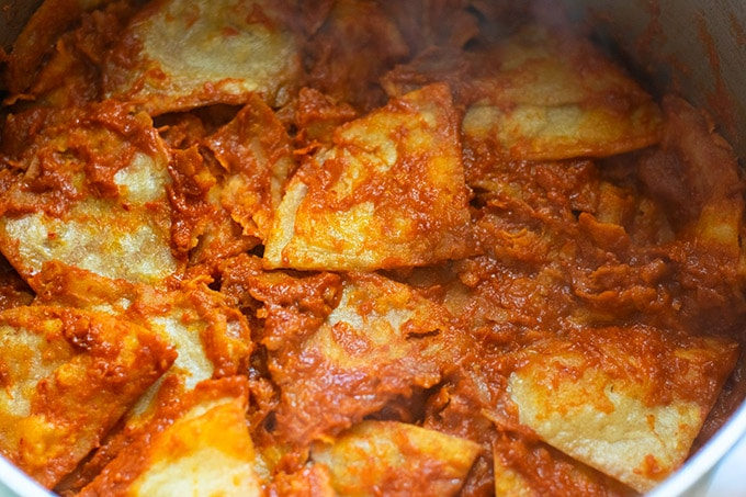 tortilla chips simmered in red sauce