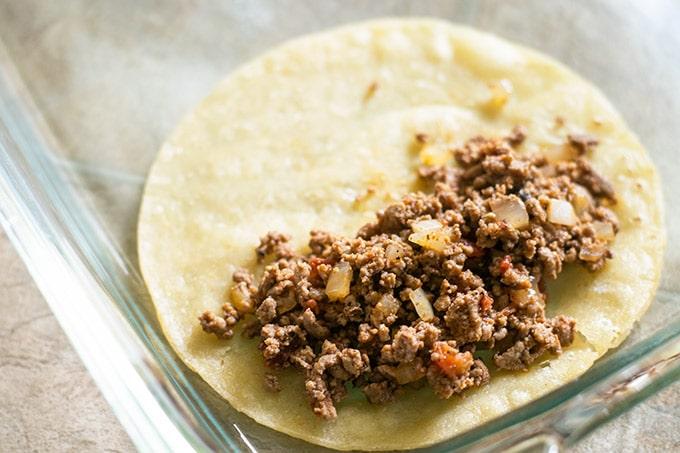 assembling beef enchiladas