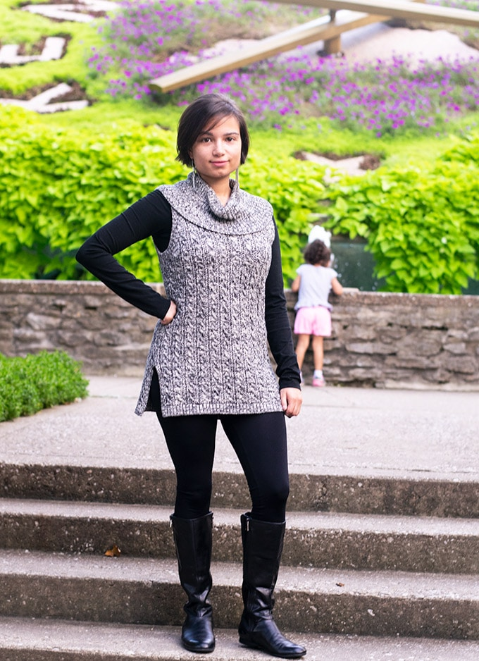 sleeveless sweater with leggings and boots