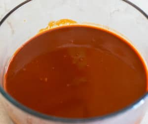 red enchilada sauce in a clear bowl