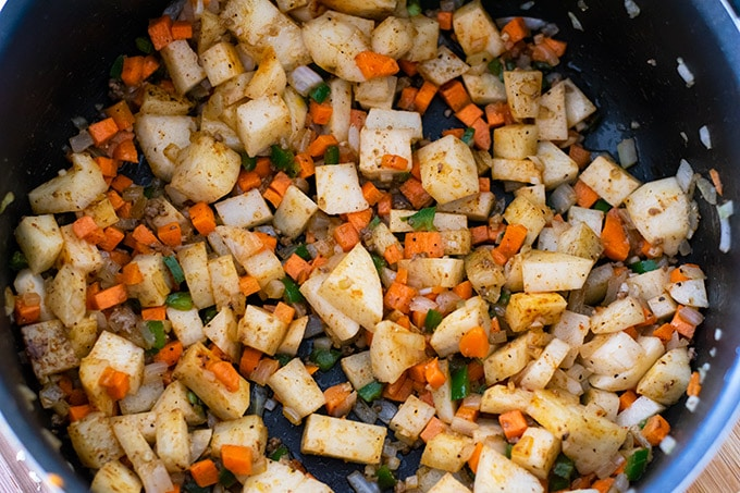 vegetables for picadillo in a pot
