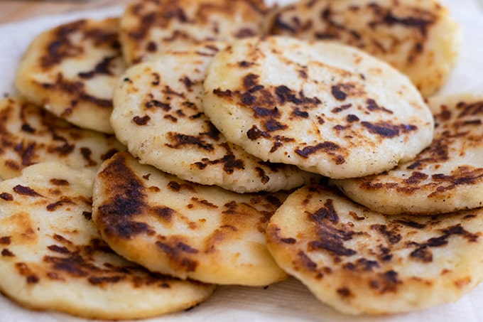 cheese arepas on a plate