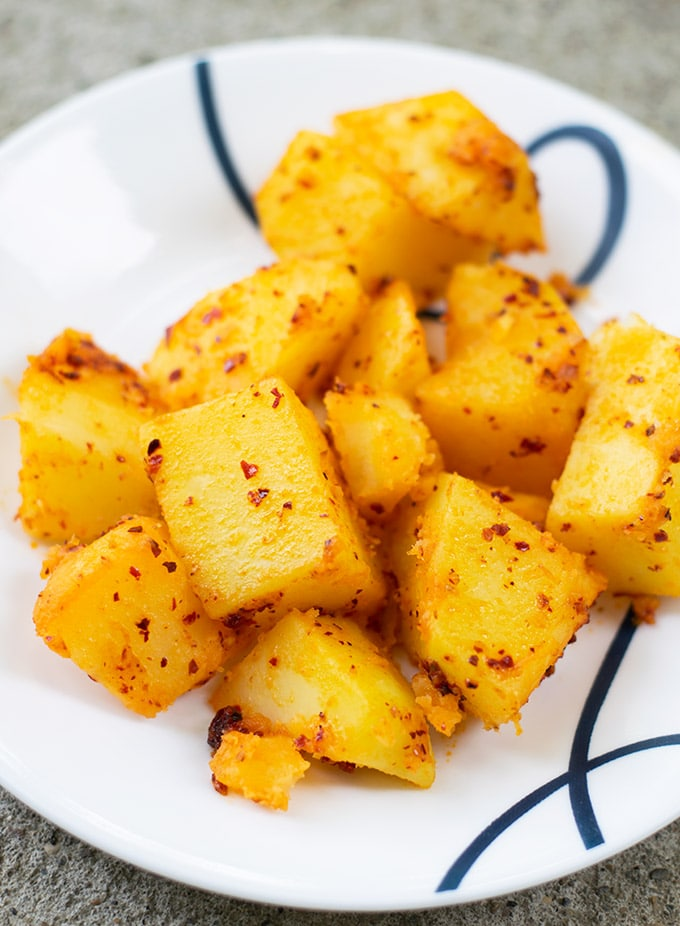 spicy potatoes recipe on a plate