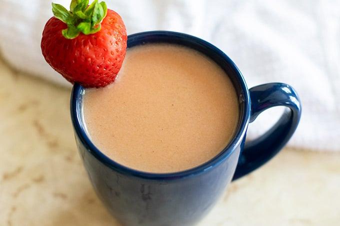 strawberry atole in a blue mug