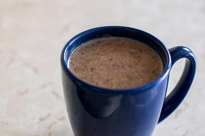 champurrado in a blue mug