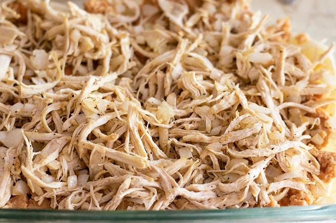assembling chicken enchilada casserole