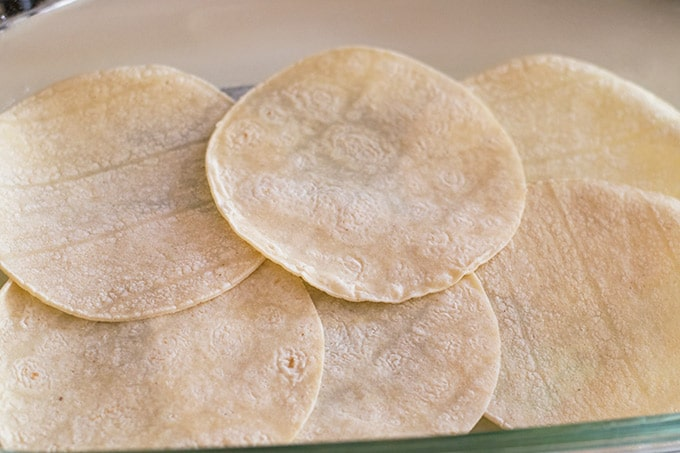 corn tortillas in a casserole dish
