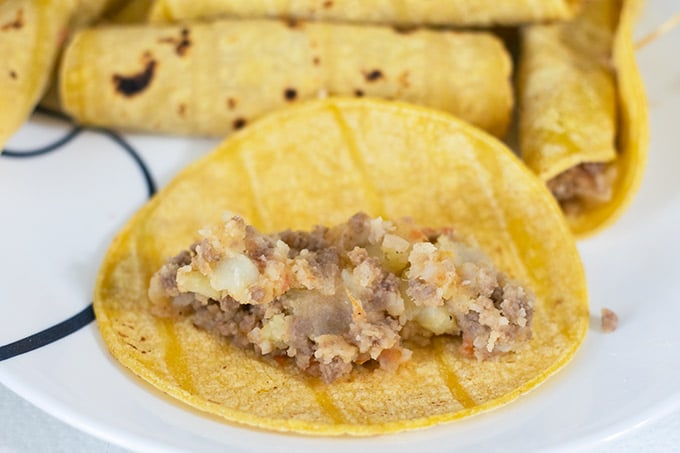 ground beef and potato filling on a tortilla
