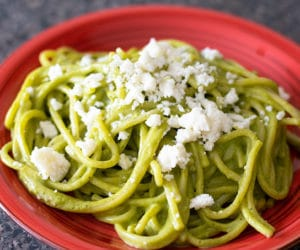 green spaghetti on a red plate
