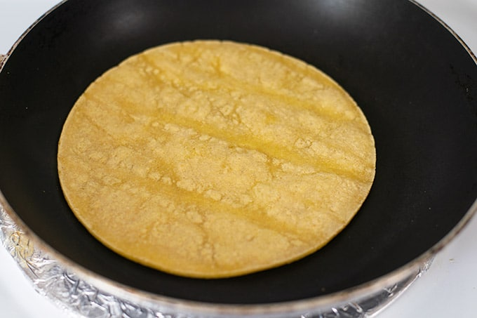 yellow tortilla in a skillet