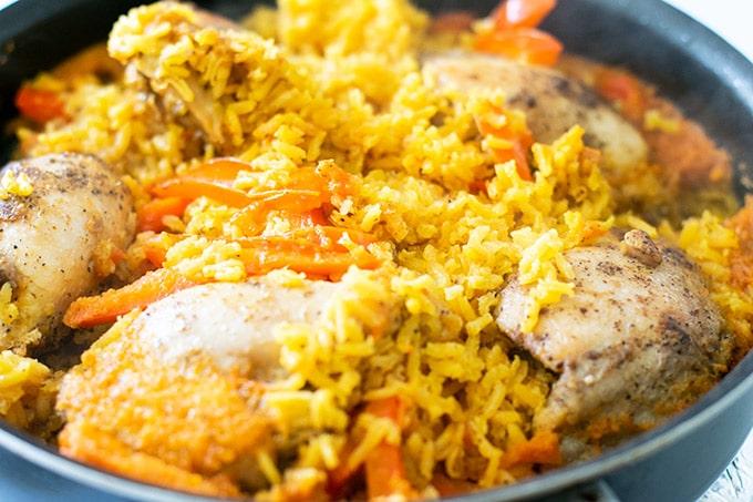 cooked arroz con pollo in a skillet