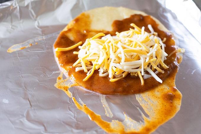 assembling cheese enchiladas