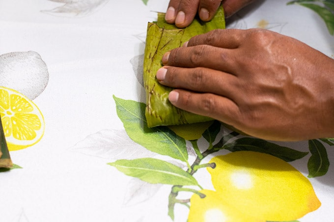 closing banana leaf tamal