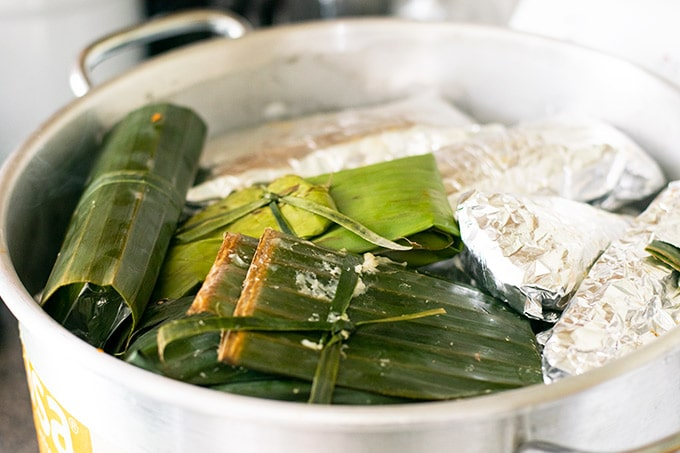 steamer filled with banana leaf tamales