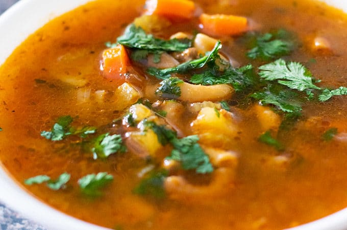 picadillo soup in a white bowl