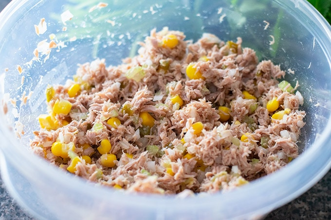 mixing tuna salad ingredients