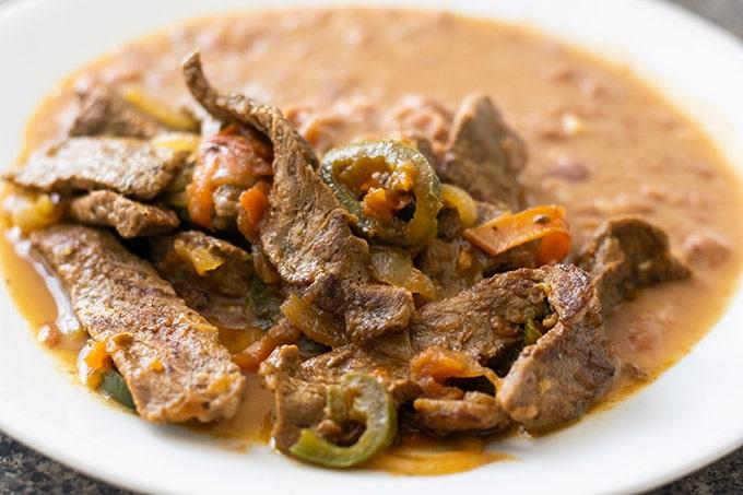 bistec a la mexicana on a white plate