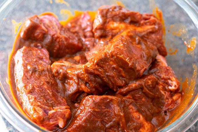 chuck roast chunks covered in a red sauce