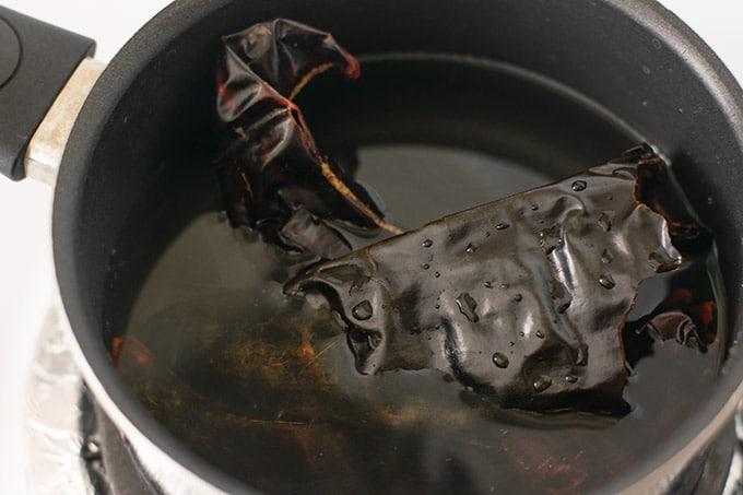 guajillo chilies in a pot