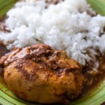 mixiote de pollo on a green plate with rice