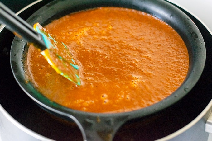 straining salsa into the broth