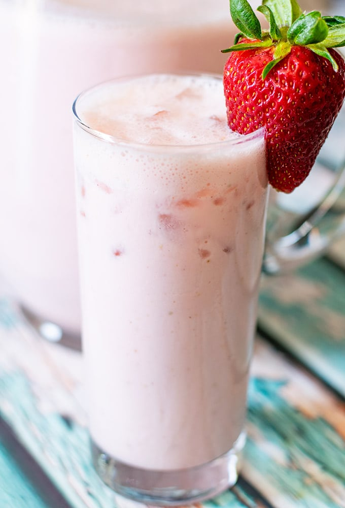 creamy strawberry agua fresca in a glass