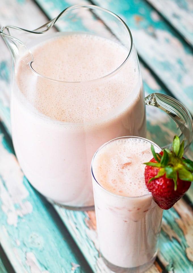 creamy strawberry agua fresca in a pitcher and glass