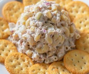 tuna macaroni salad and crackers on a white plate