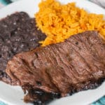 carne asada on a plate with rice and beans