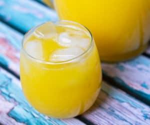 mango agua fresca in a glass