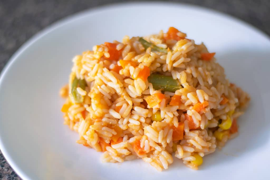arroz rojo with veggies on a plate