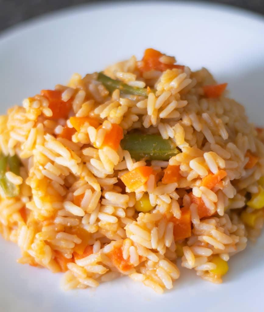 arroz rojo on a white plate