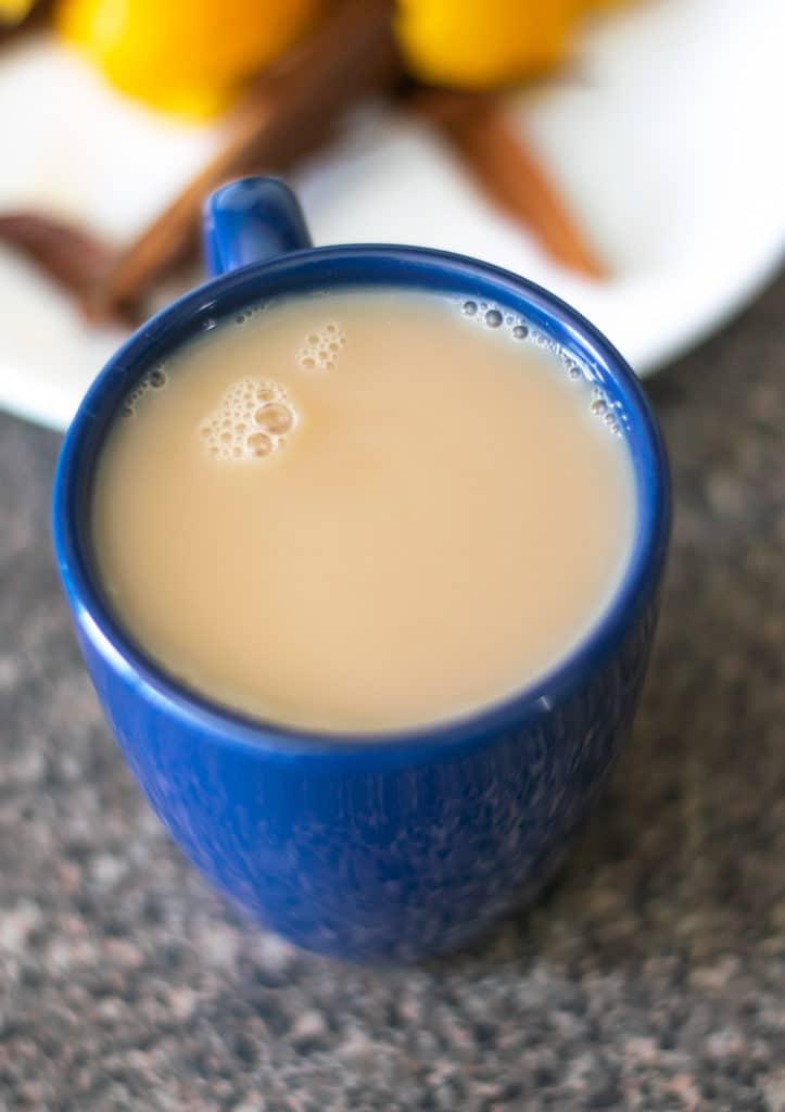 orange cinnamon spice tea in a blue mug