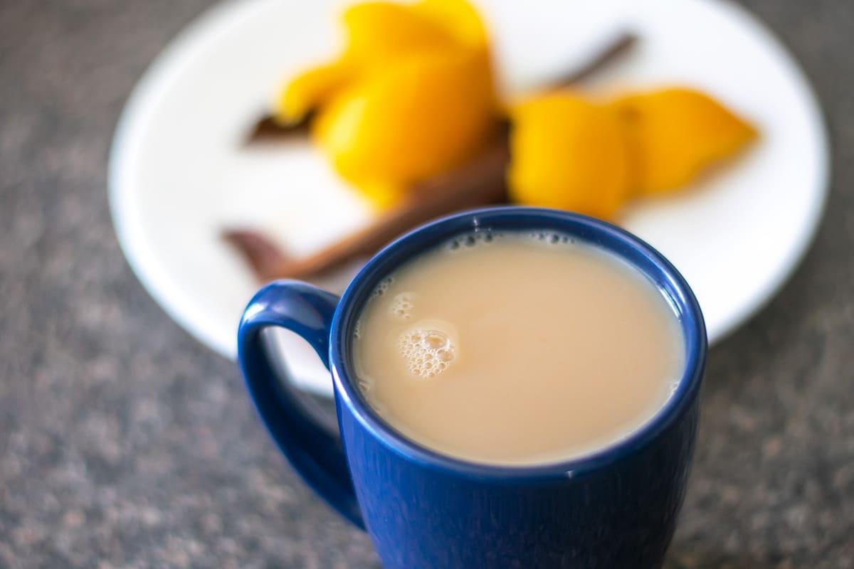 cinnamon orange spice tea in a blue mug