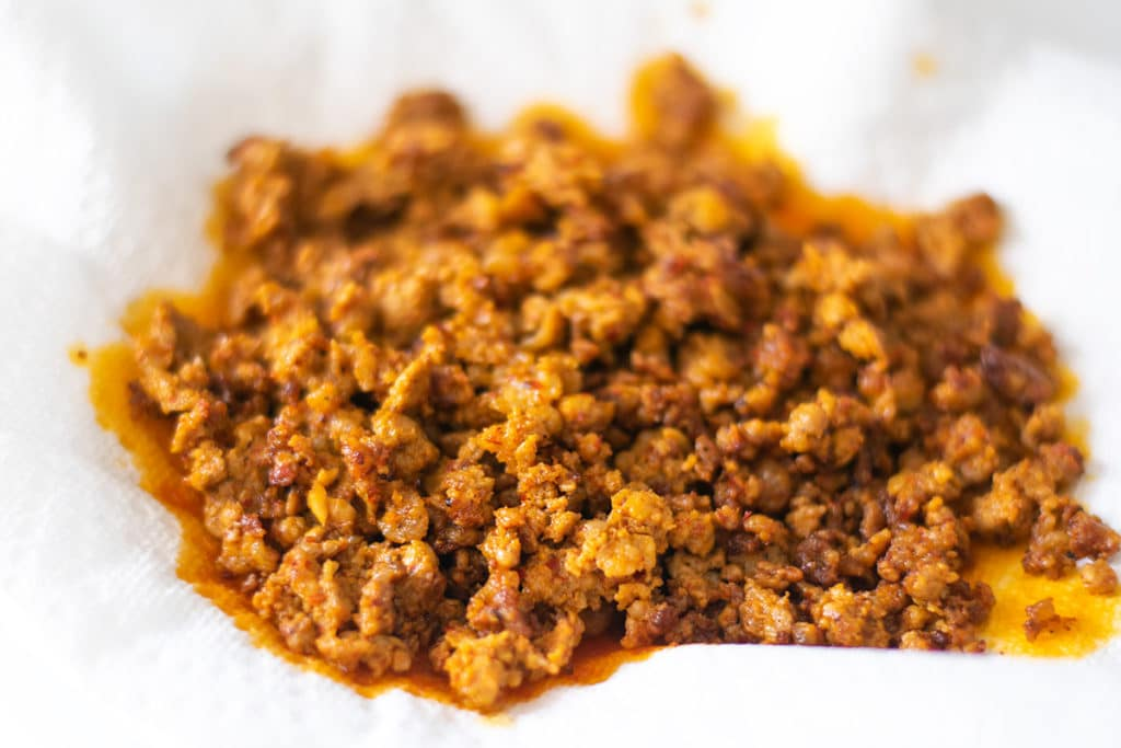 crumbled chorizo on a paper towel lined plate
