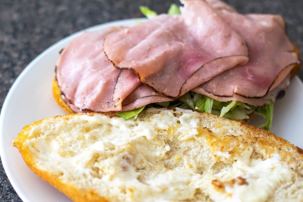 assembling a Mexican ham sandwich