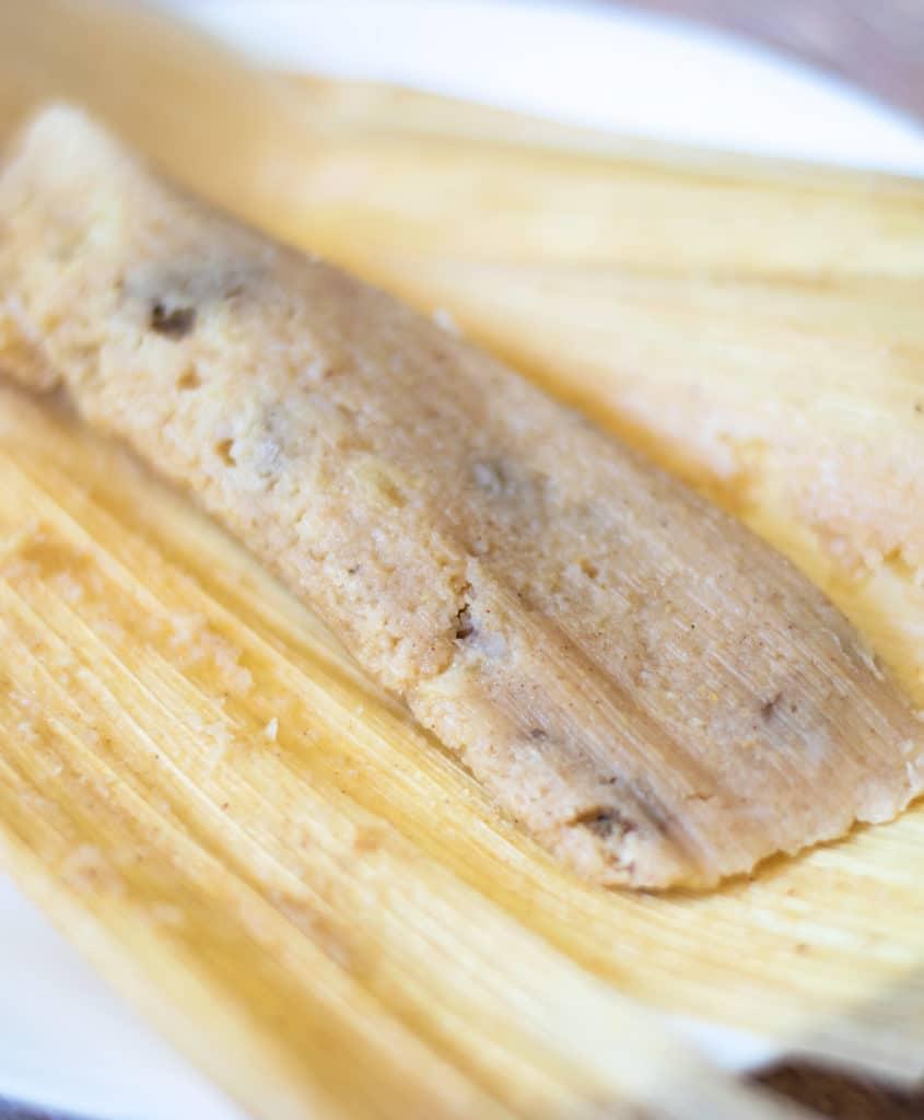 tamal dulce (sweet tamale) on a white plate
